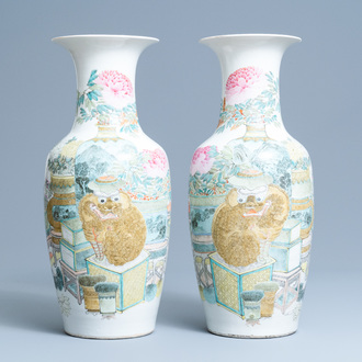 A pair of Chinese qianjiang cai vases with antiquities and buddhist lions, 19/20th C.