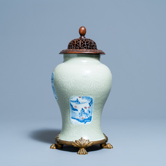 A Chinese incised celadon-glazed vase with blue, white and copper red panels, Kangxi