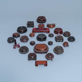 26 Chinese carved wooden stands, 19/20th C.