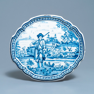 A Dutch Delft blue and white plaque with a hunter, 18th C.
