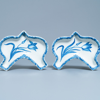 A pair of Dutch Delft blue and white carnation flower dishes, 18th C