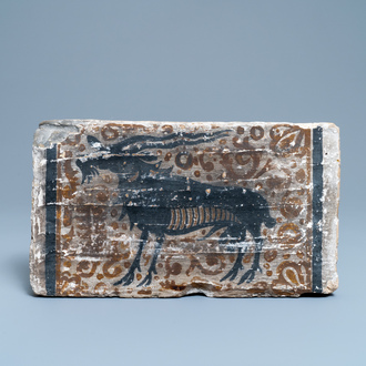 A Spanish pottery socarrat or ceiling tile with a buck, Paterna, 14/15th C.