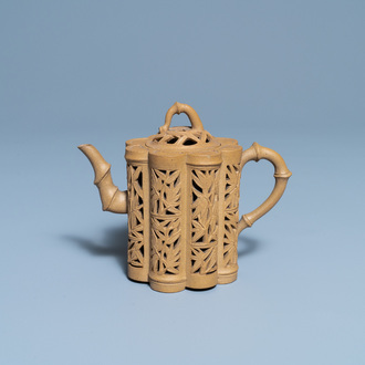 A Chinese reticulated Yixing stoneware teapot and cover, Kangxi