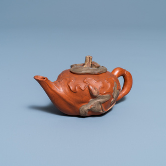 A Chinese relief-decorated Yixing stoneware teapot and cover, 18/19th C.