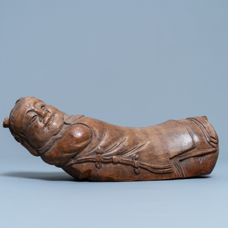 A Chinese bamboo 'recumbent boy' pillow, 19th C.