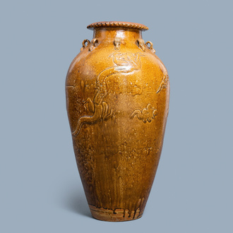 A large Chinese brown-glazed relief-molded martaban jar with dragons, Qing