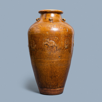 A large Chinese brown-glazed relief-molded and incised martaban jar, Qing