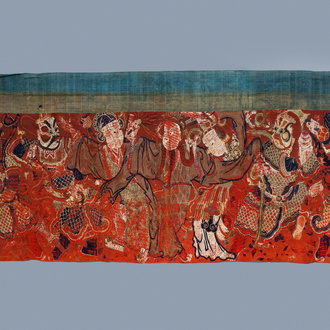 A large Chinese horizontal embroidered red-ground textile panel, 19th C.