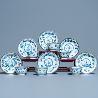 Six Chinese blue, white and copper red cups and saucers, Kangxi