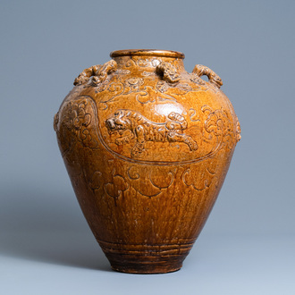 A large Chinese brown-glazed relief-molded martaban jar with Buddhist lions, Ming