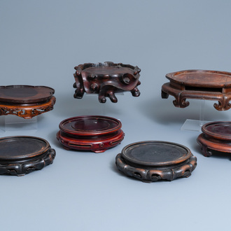 Seven large Chinese carved wooden stands, 19/20th C.
