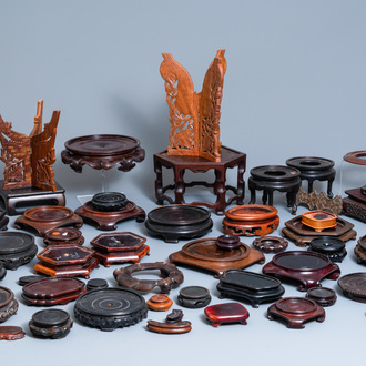 A varied collection of ca. 50 Chinese carved wooden stands, 19/20th C.