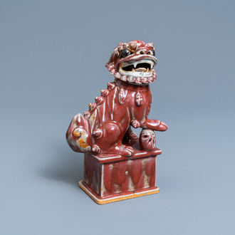 A Chinese monochrome sang de boeuf model of a Buddhist lion, 19th C.