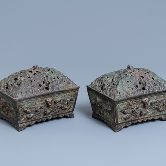 A pair of Chinese Ming-style bronze censers with reticulated covers, 19th C.