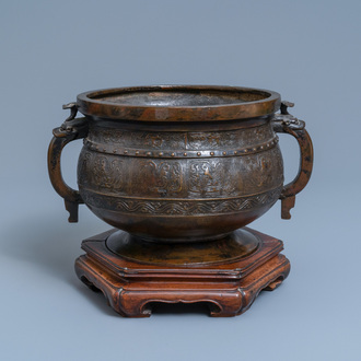A large Chinese bronze 'Gui' vessel on hardwood stand, Yuan