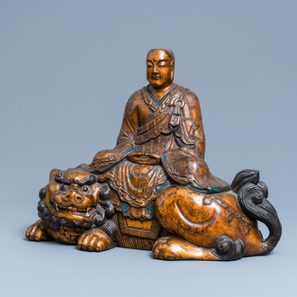 A large Japanese gilded, lacquered and painted wooden figure of Monju on a shishi, Edo/Meiji, 18/19th C.