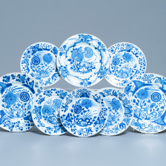 Eight Chinese blue and white plates with birds among blossoms, Kangxi
