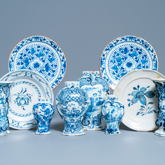 A varied collection of blue and white Dutch Delft plates and vases, 18th C.