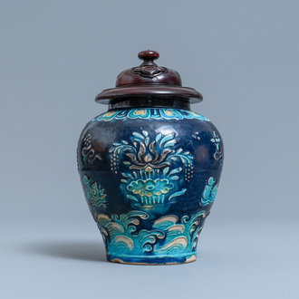 A Chinese fahua vase with mandarin ducks in a lotus pond, Ming