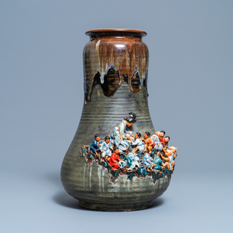 A tall Japanese Sumida Gawa vase with applied design of children and monkeys, Meiji, 19/20th C.