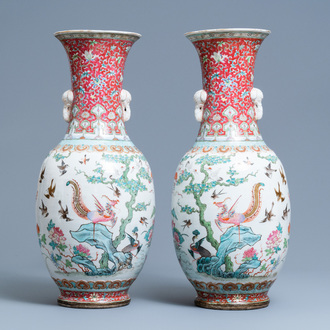 A pair of Chinese famille rose 'phoenix' vases, Tongzhi mark and of the period