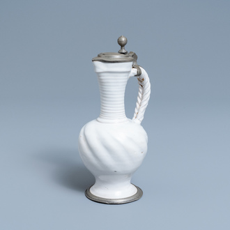 A pewter-mounted white Dutch Delftware jug, 17th C.