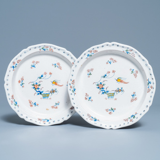 A pair of deep Brussels faience plates with 'à la haie fleurie' design, 18th C.