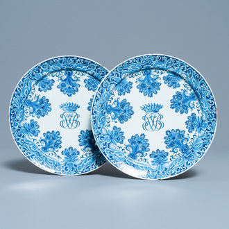 A pair of Dutch Delft blue and white plates with crowned monograms, 1st quarter 18th C.