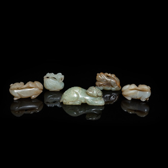 Five Chinese celadon and russet jade carvings, 19th C.
