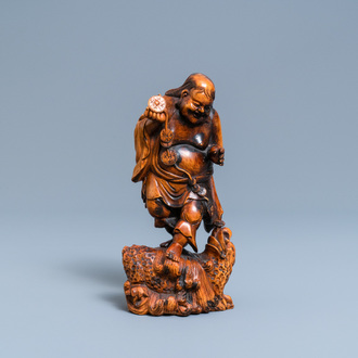 A Chinese carved boxwood figure of Liu Hai, Qing
