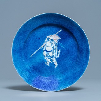 A Chinese blue, white and copper red powder blue-ground dish, Kangxi