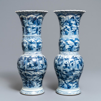 A pair of Chinese blue and white yenyen vases with figures in landscapes, Kangxi