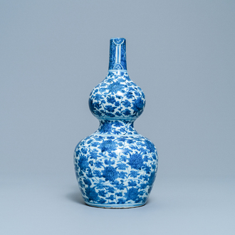 A Chinese blue and white 'lotus scroll' double gourd vase, Wanli