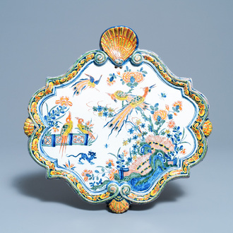 A polychrome Dutch Delft plaque with birds in a Chinese garden, 18th C.
