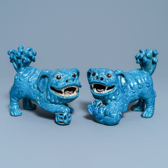 A pair of Chinese robin's egg-glazed models of Buddhist lions, 19th C.