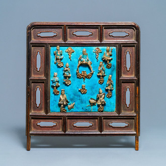 A Chinese square fahua 'Immortals' plaque mounted in a wooden table screen, Ming