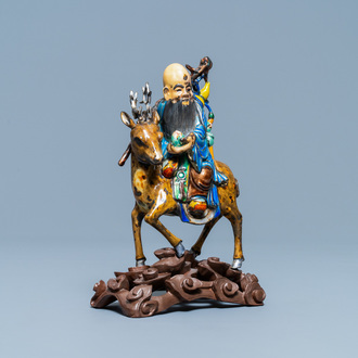 A Chinese enamelled silver figure of Shou Lao on a deer, 19th C.