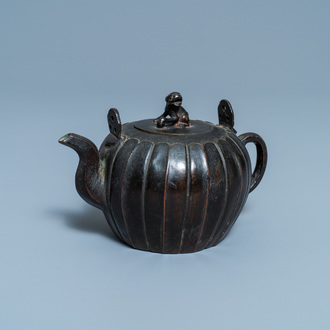 A Chinese lacquered bronze teapot and cover, Yuan
