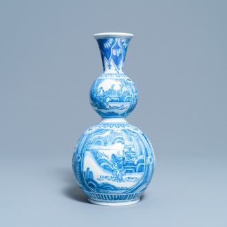 A Dutch Delft blue and white chinoserie double gourd vase, late 17th C.