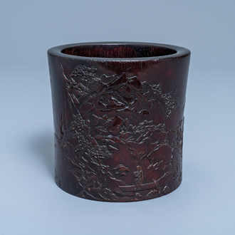 A Chinese carved zitan wood brush pot with a mountainous landscape, 17/18th C.