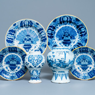 Four Dutch Delft blue and white 'peacock feather' plates and two vases, 18th C.