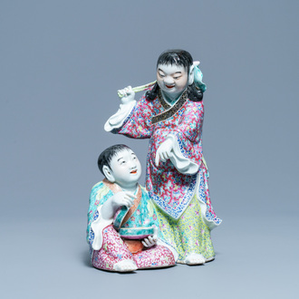 A Chinese famille rose group of two boys with a bat, seal mark, Republic