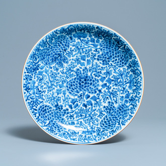 A Chinese blue and white dish with floral design, Kangxi