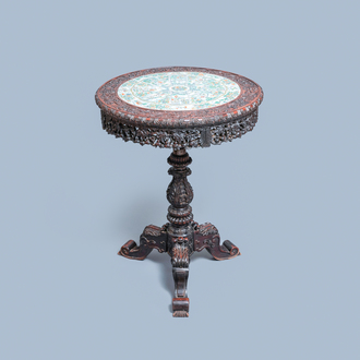 A Chinese carved wooden table with a large Canton famille verte plaque, 19th C.