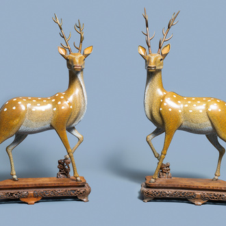 An exceptional and large pair of Chinese cloisonné models of deer, Qianlong/Jiaqing