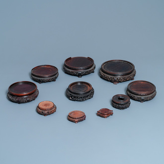 Ten Chinese reticulated carved wooden stands, 19/20th C.