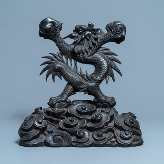 A large Chinese carved wooden 'dragon' stand for a dish or a mirror, 19th C.
