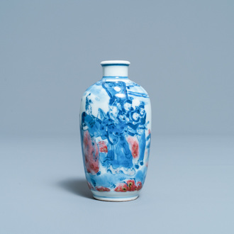 A small Chinese blue, white and copper-red vase, 19th C.