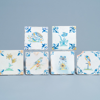 Six polychrome Dutch Delft tiles with birds, insects and flowers, 17th C.