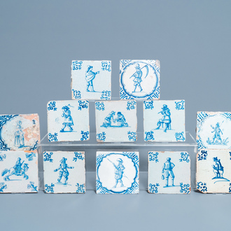 Twelve Dutch Delft blue and white tiles with figures, 17th C.